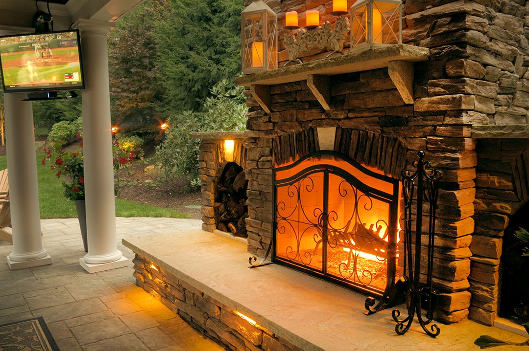 Rustic Stone Fireplace with Custom Outdoor Kitchen designed by Beall's Landscaping